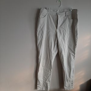 Cream-colored straight legged jeans